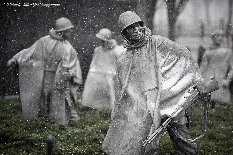 Winter at the Korean War Veterans Memorial as snow begin to cover statues cover Washington DC