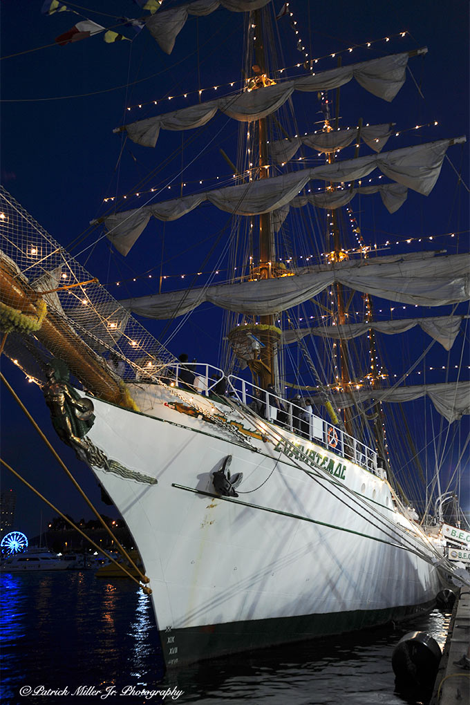 Schooner docked in Baltimore Harbor at night with lights