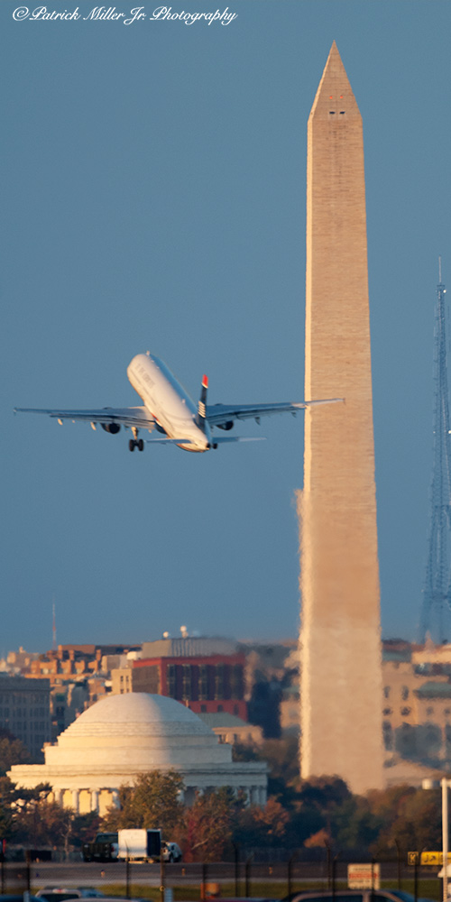 Jet taking off over nearby Washington Monuments, departing Ronald Reagan National Airport, VA, DC