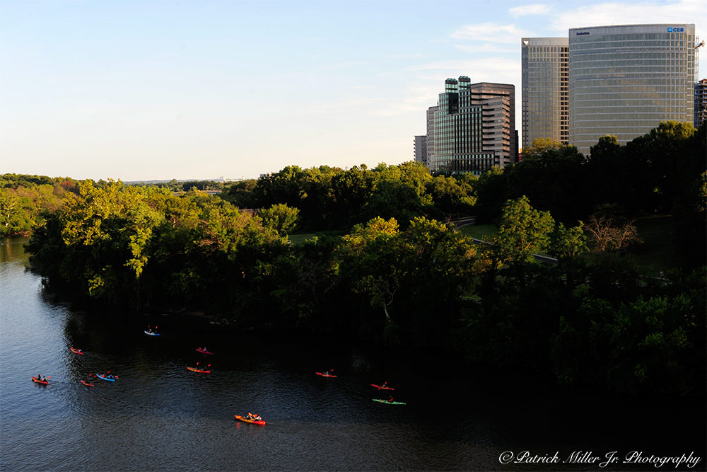 Group of kayakers on the Potomac River entering Theodore Roosevelt waterway Rosslyn, VA