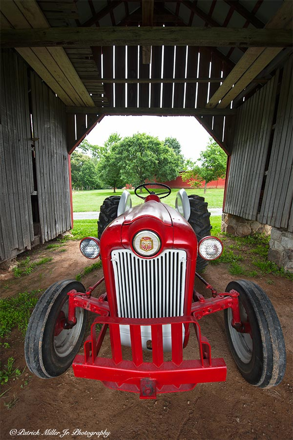 Vintage Ford tractor in a wooden barn Maryland