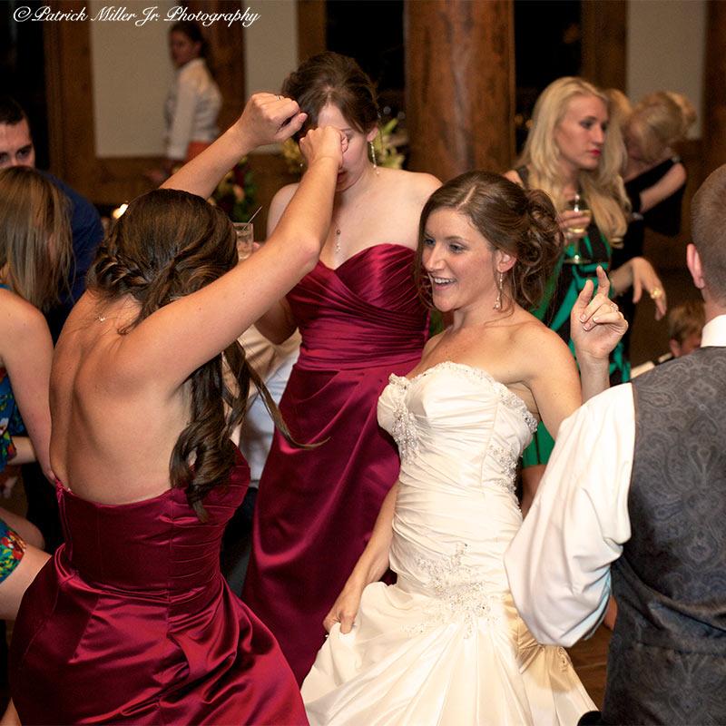 Bride dancing with brides maids CO