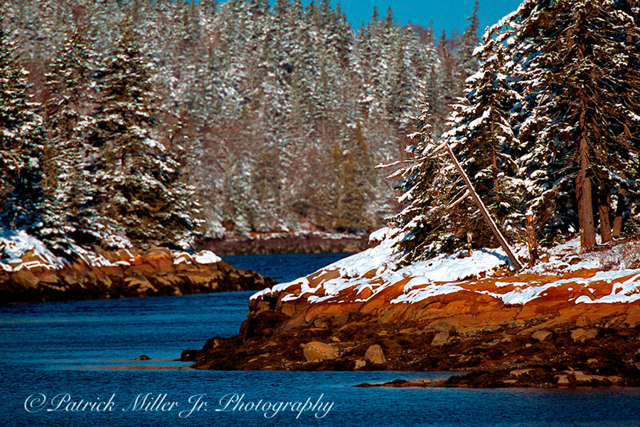Winter cove with snow on the rocky shoreline Vinalhaven, Maine