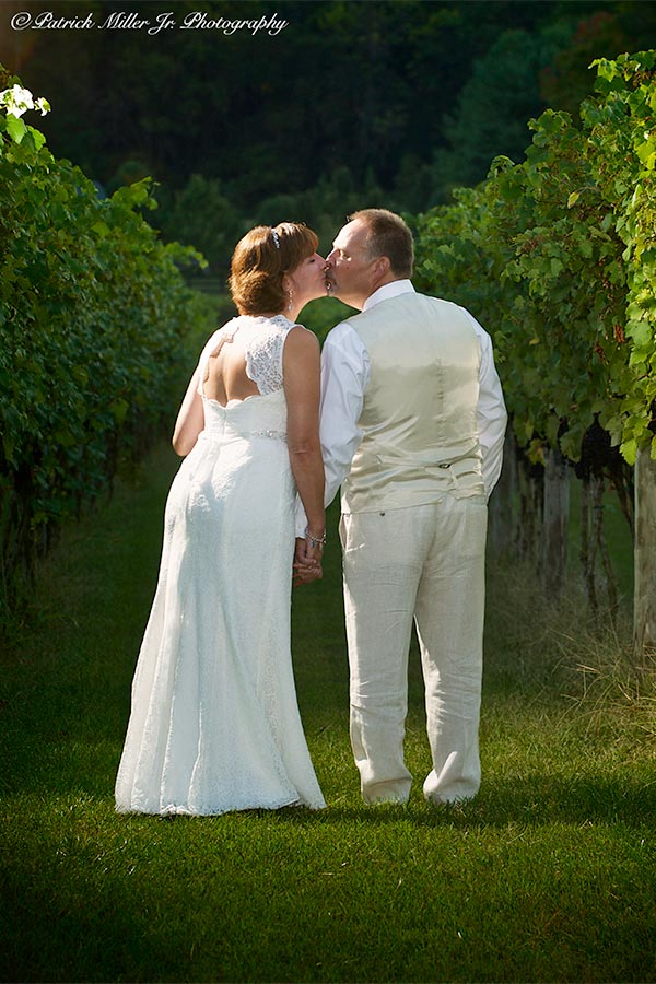 Bride and Groom Kiss Vineyard, Virginia
