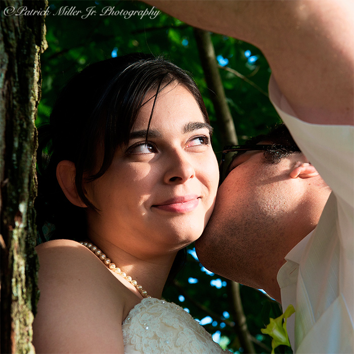 Groom Kissing Bride Under Tree CO