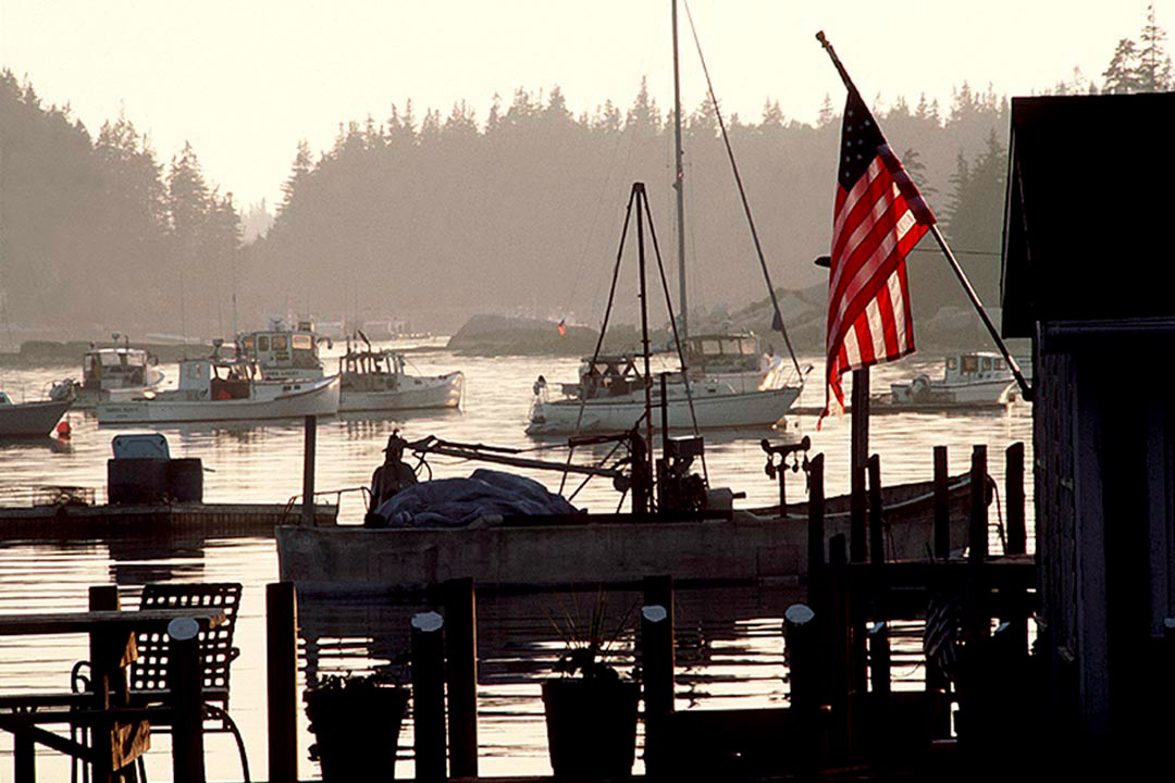 Silhouette of a lobster shack with the American flag in Maine