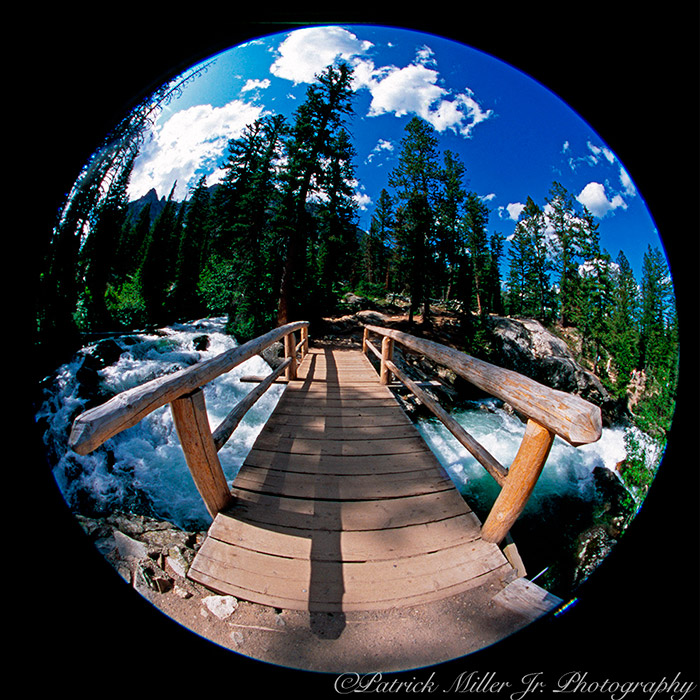 Bridge spanning the raging rapids of Fall Creek in Grand Tetons National Park WY, MT