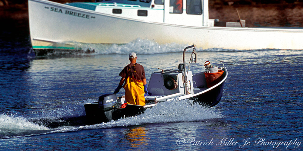Lobsterman working on a boat in the Atlantic Ocean Maine