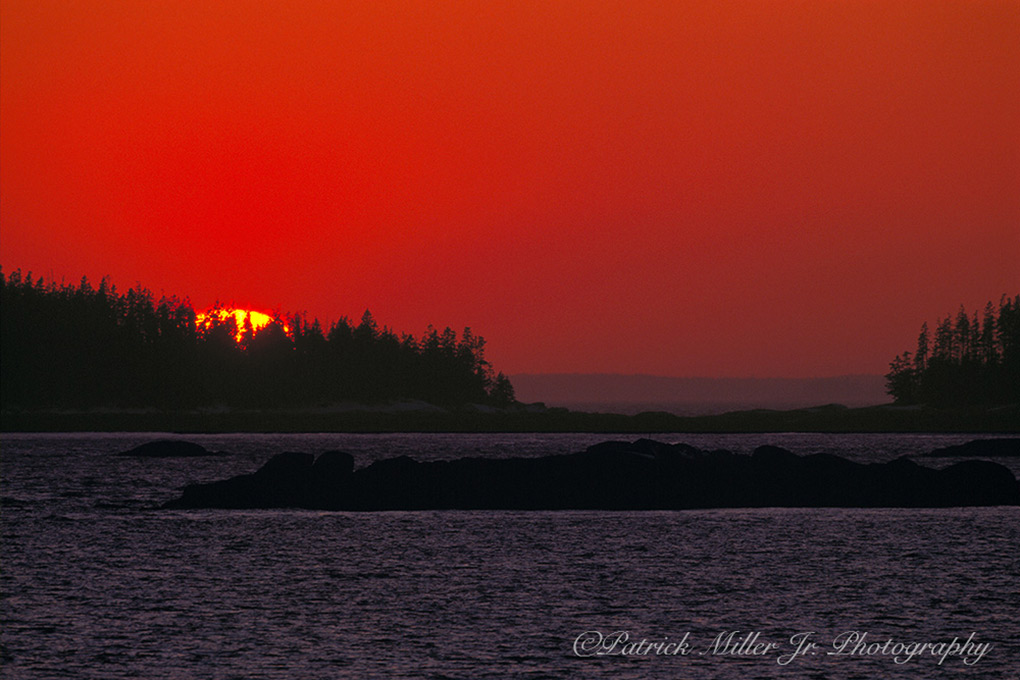 Sun setting over Atlantic Ocean Islands, Maine