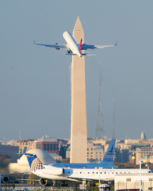 US Airways Jet rising over the Washington Monument, DC