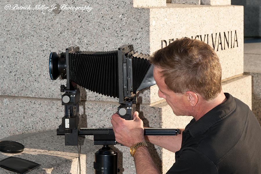 Setting up Arca Swiss large format camera with a Schneider 5.6/210 lens at the WWII Memorial Washington, DC