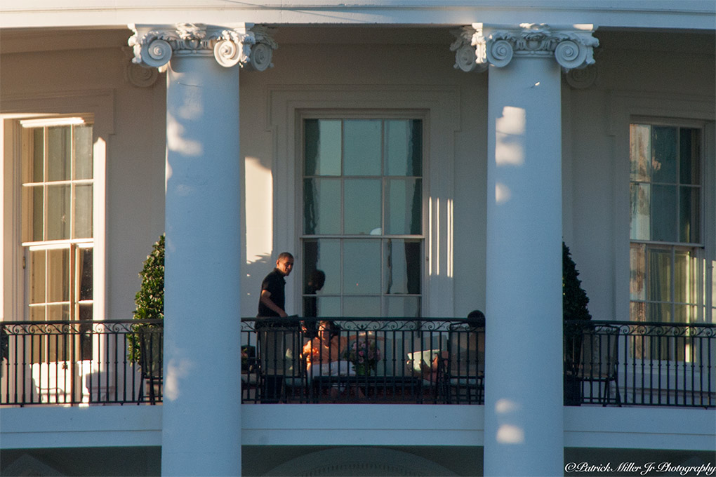 President Obama relaxing on the White House Truman Balcony Washington, DC
