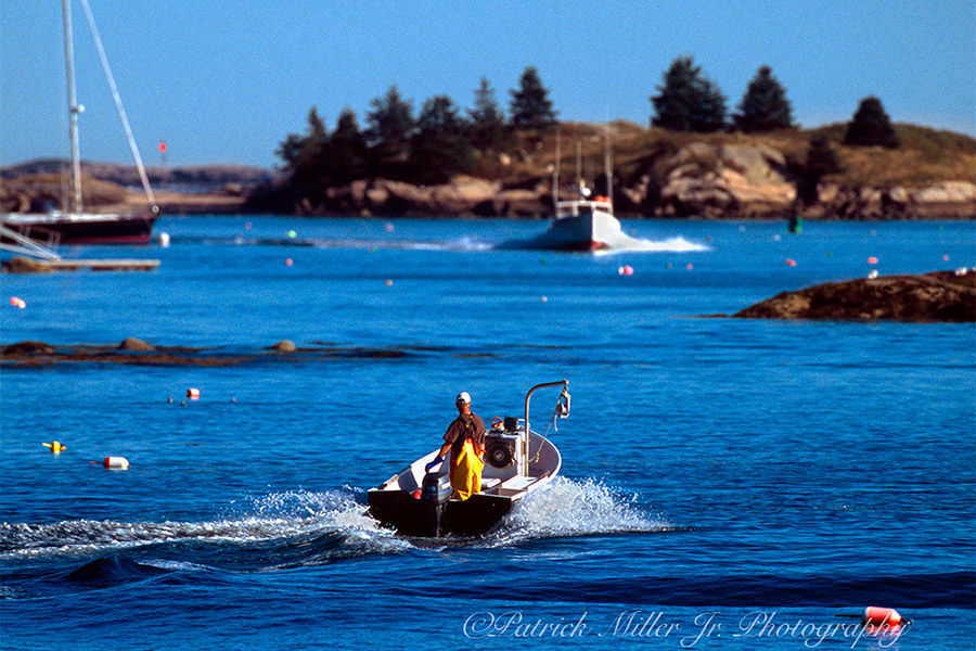 Lobsterman working on the Atlantic Ocean around one of Maines many Islands