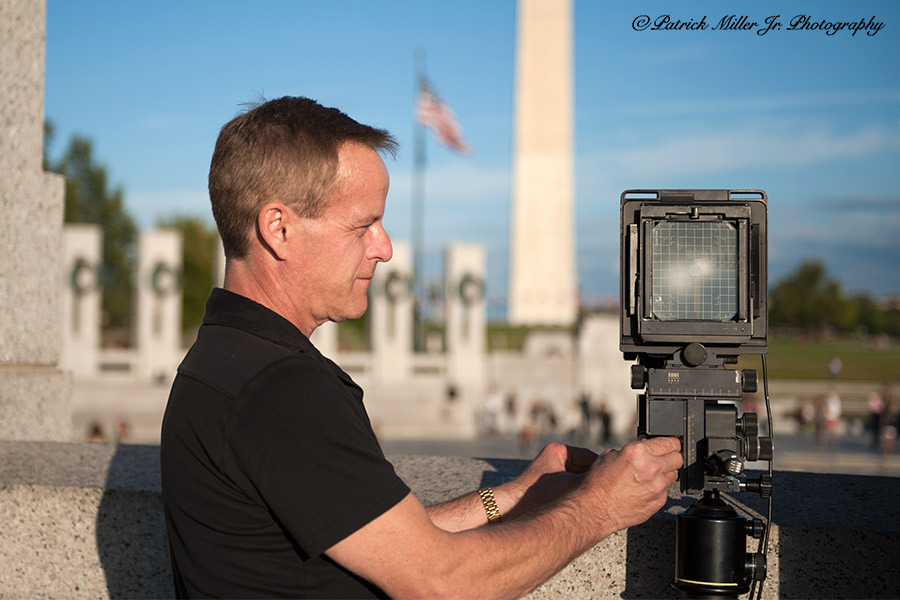 Leveling a large format camera at the WWII Memorial Washington, DC