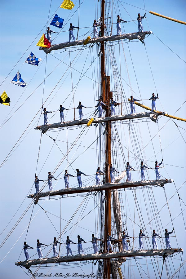 "Sailers atop schooner masts on the 200th anniversary of the Battle of Baltimore with the British called ""Sailabration"""