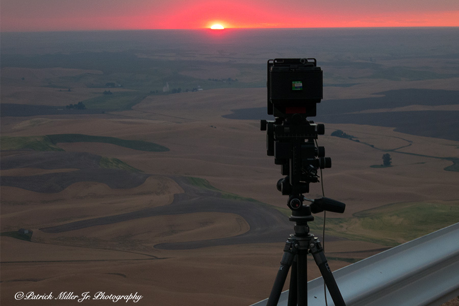 Arca Swiss large format camera capturing a sun setting over Washington State farmlands.