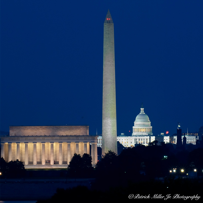 The Washington Monument, Lincoln Memorial and US Capitol at night in Washington, DC