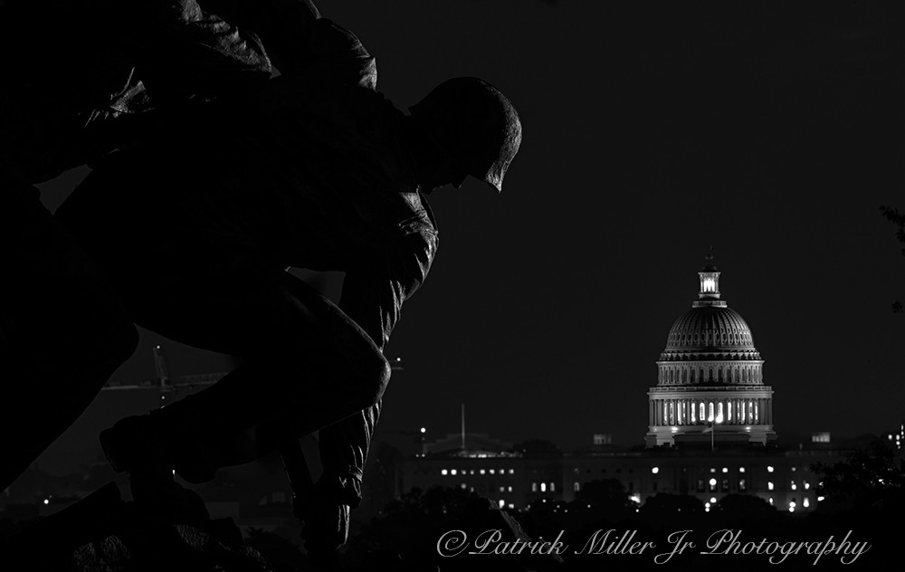 Iwo Jima Marines Memorial silhouette and the Washington US Capitol at night Arlington, VA and Washington, DC In black and white