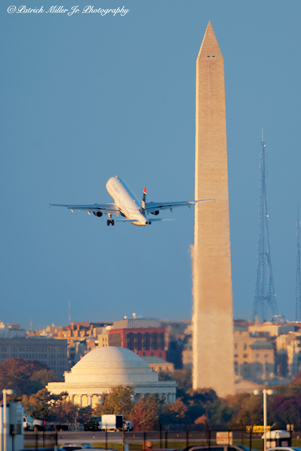 Plane taking off from Reagan International Airport over Washington Monuments, DC, VA