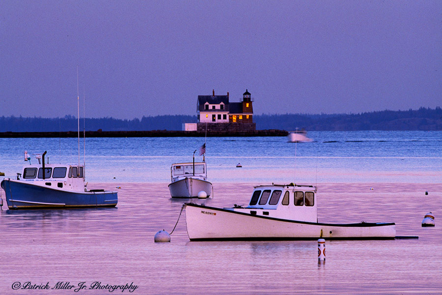Sun Setting On the Breakwater Lighthouse in Rockland, ME